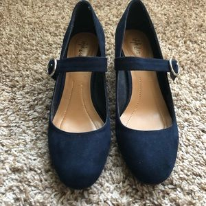 Black heel navy Mary Janes.